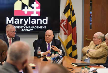 Governor Hogan with MD Emergency Management team discussing information and resources on COVID-19